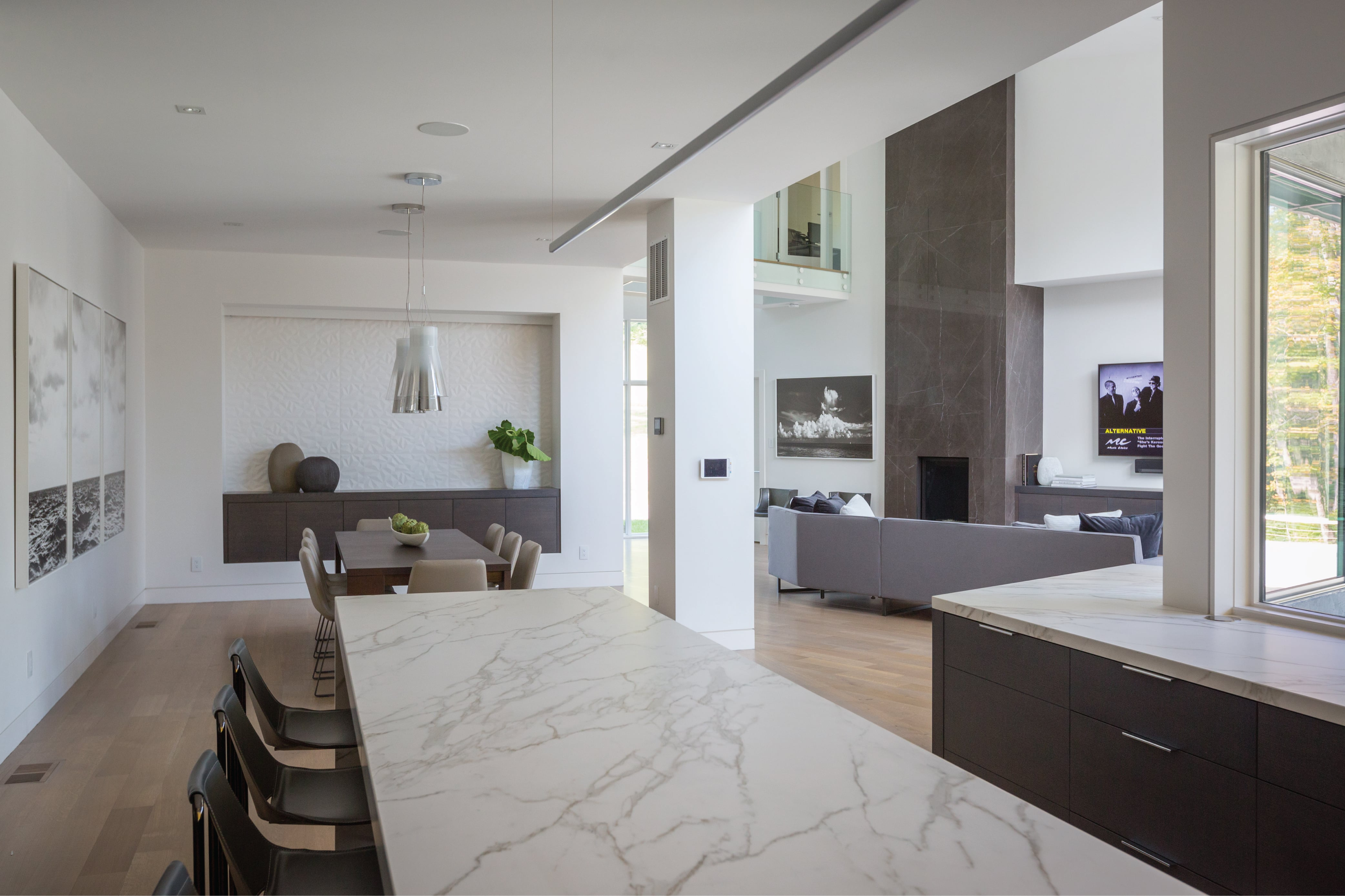 Open concept modern living room, dining and kitchen in this contemporary home designed by interior designer, RM Interiors.
