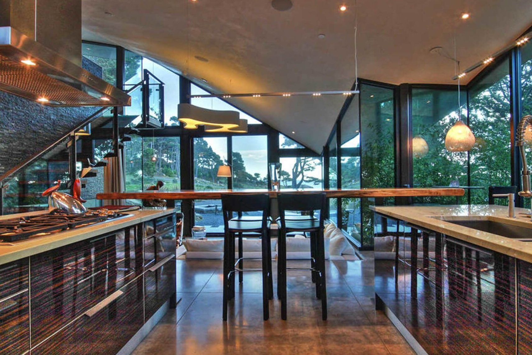 Custom kitchen with views of the coast by interior designer, RM Interiors.