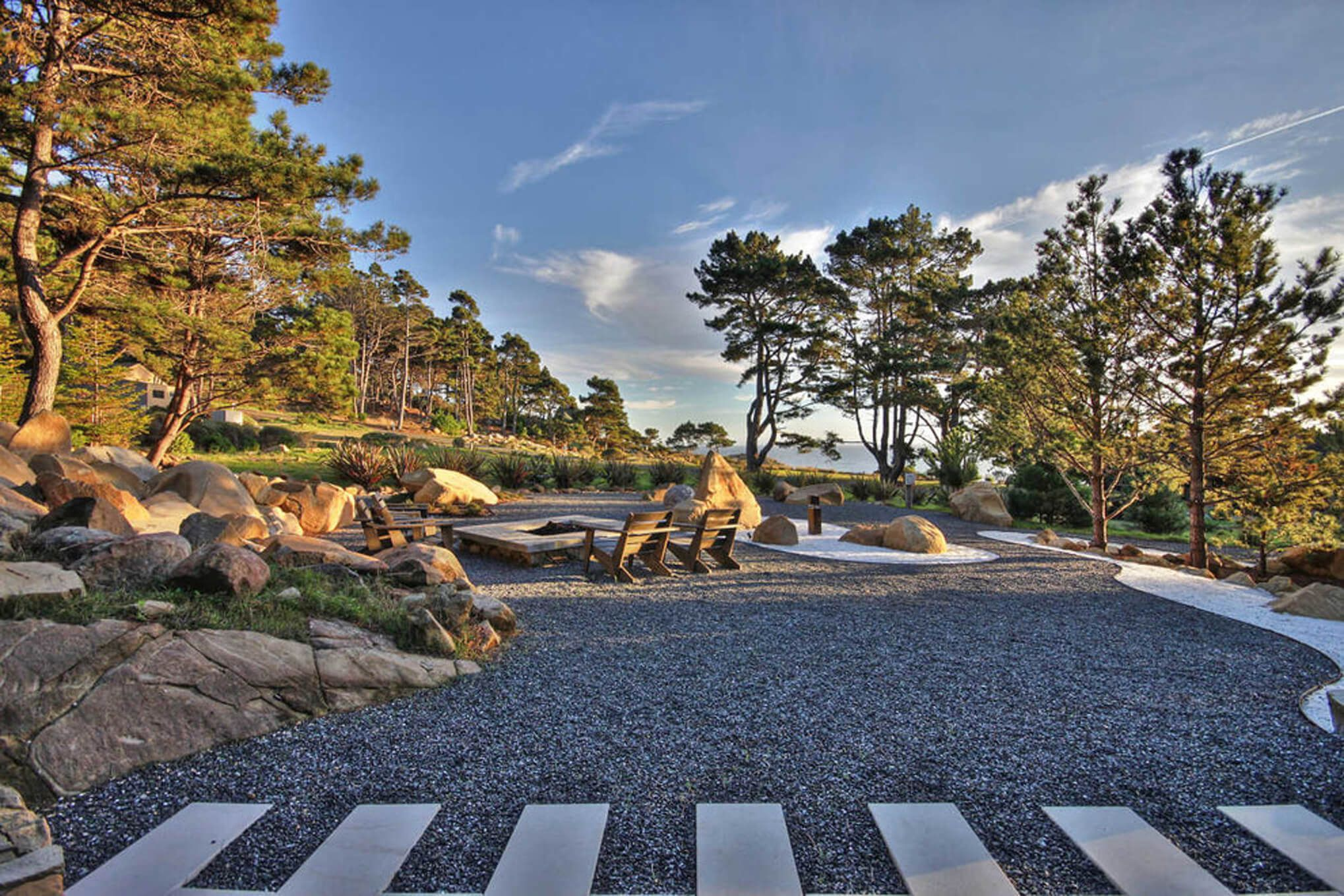Custom fire pit with views of the coast designed by interior designer, RM Interiors.