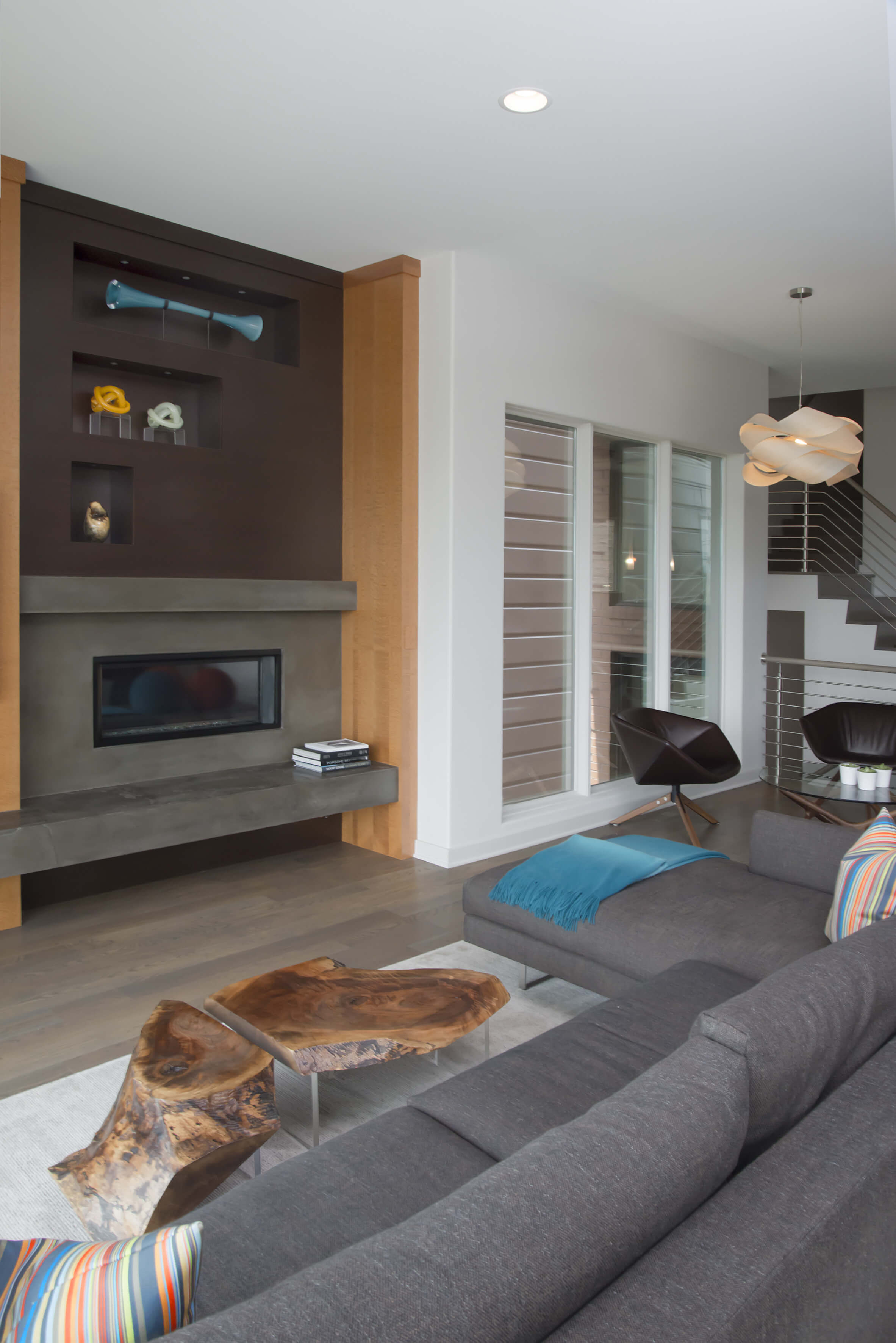Living room featuring custom contemporary stone fireplace. Design by Cincinnati Interior Designer, RM Interiors.