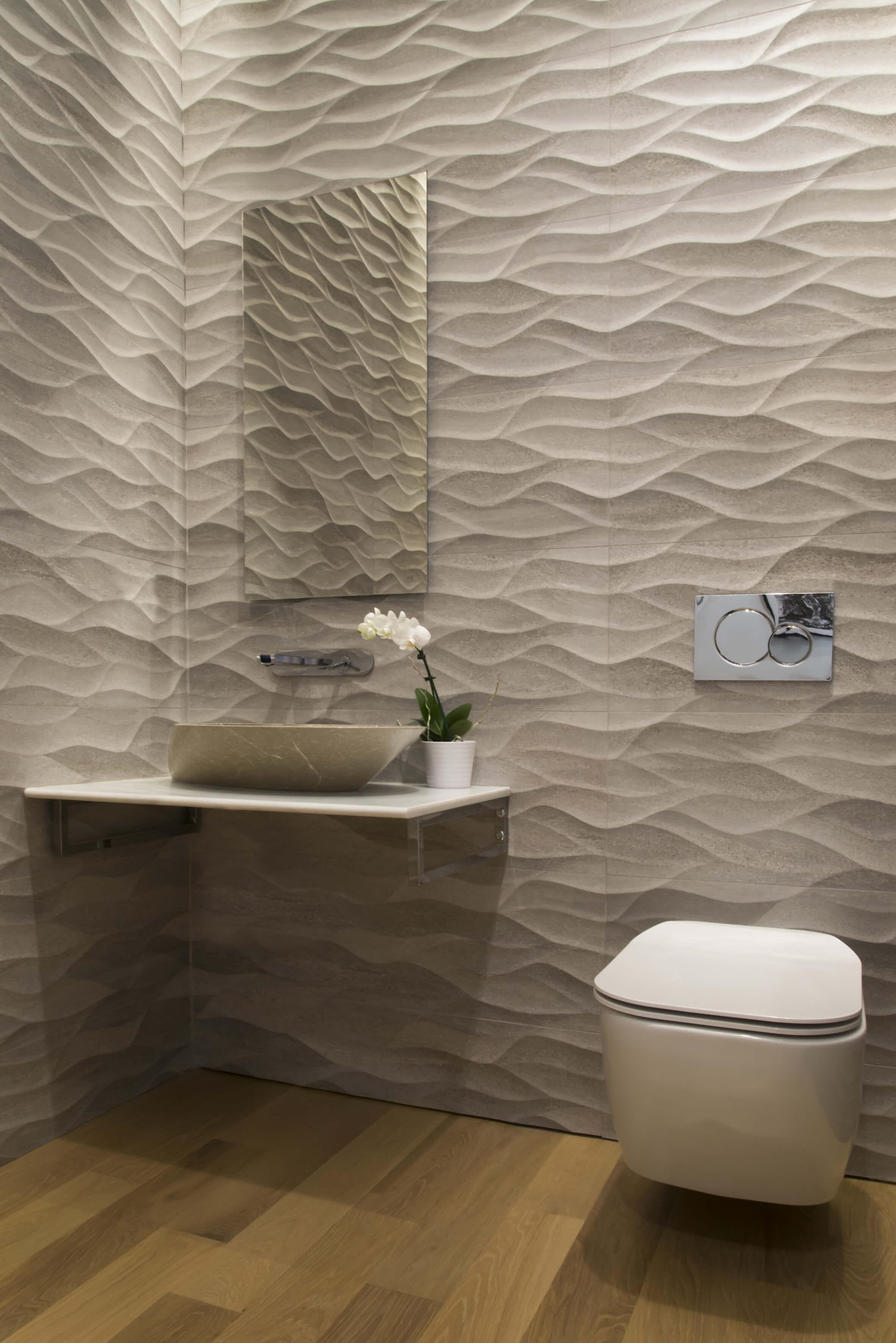 Custom contemporary bathroom with textured Porcelanosa tile designed by Interior Designer RM Interiors.