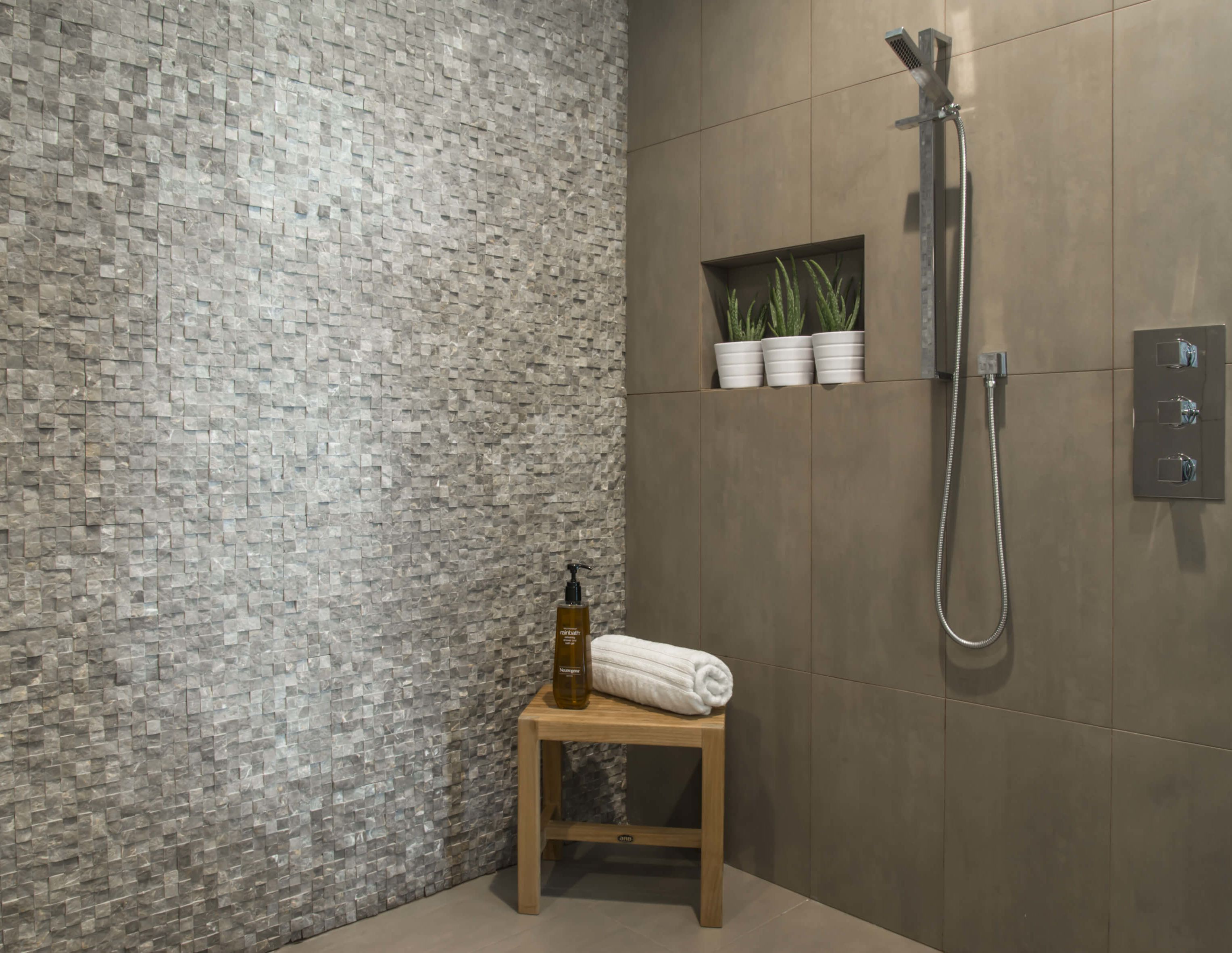 Spa like natural stone and porcelain stone shower designed by Cincinnati Interior Designer, RM Interiors.