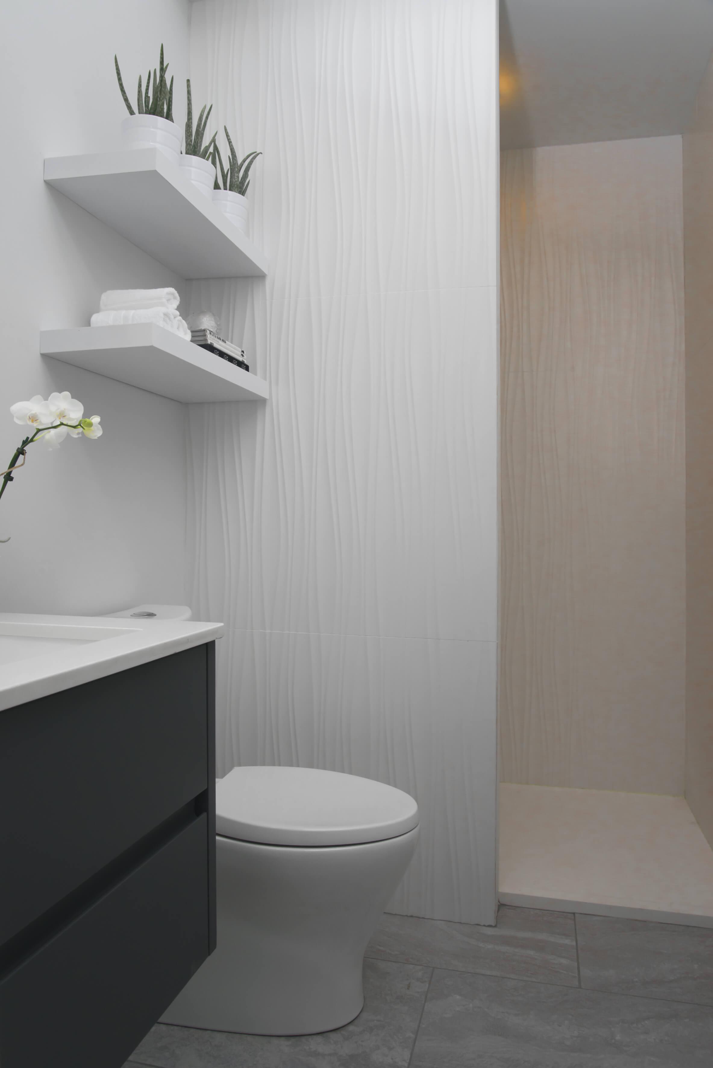 White and minimal bathroom designed by Cincinnati Interior Designer, RM Interiors.
