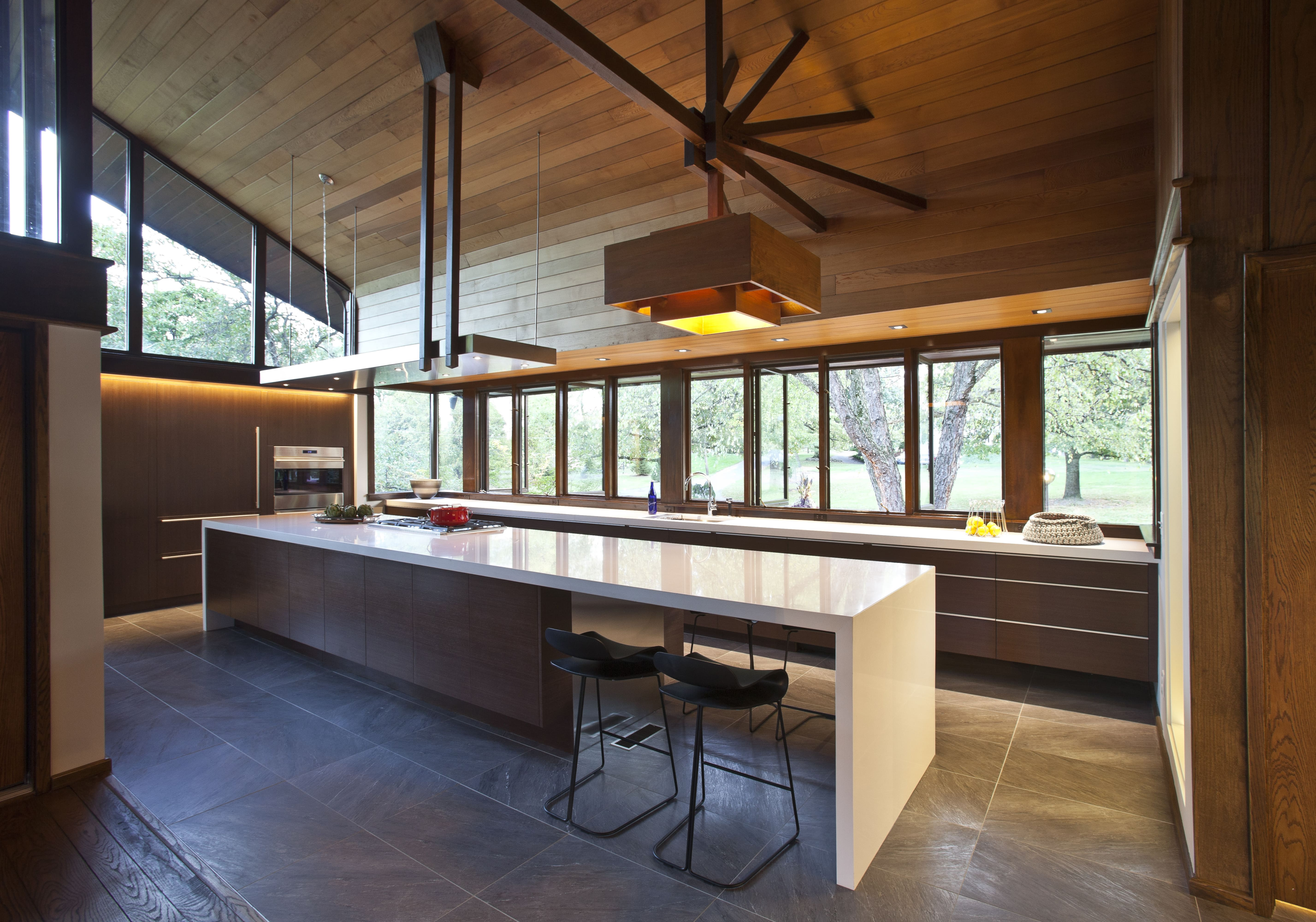 Feature photo of the custom kitchen island, blending modern interiors with mid-century architecture, design by interior designer, RM Interiors in Cincinnati.