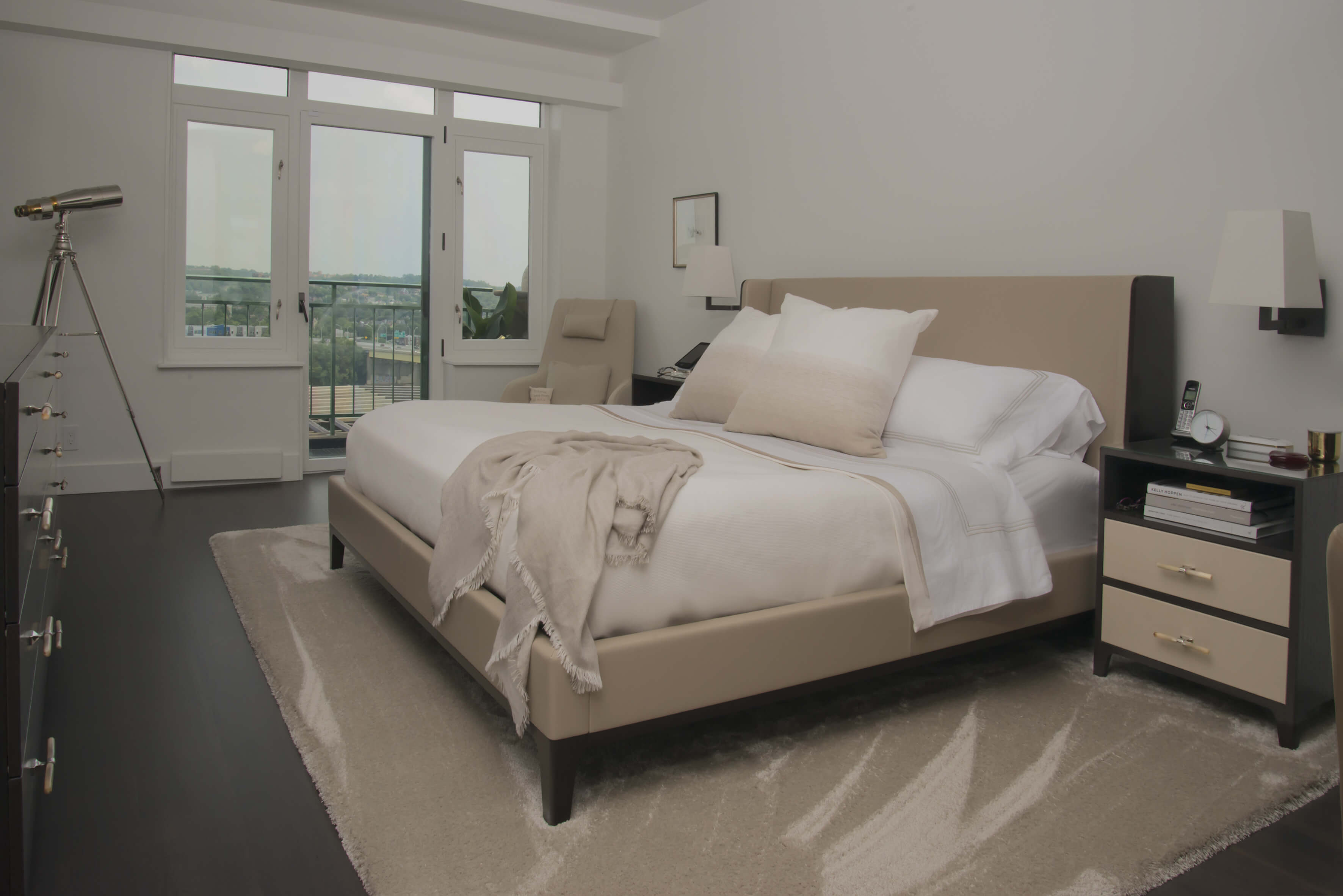 Sophisticated and cozy modern bedroom with warm tones designed by interior designer, RM Interiors.