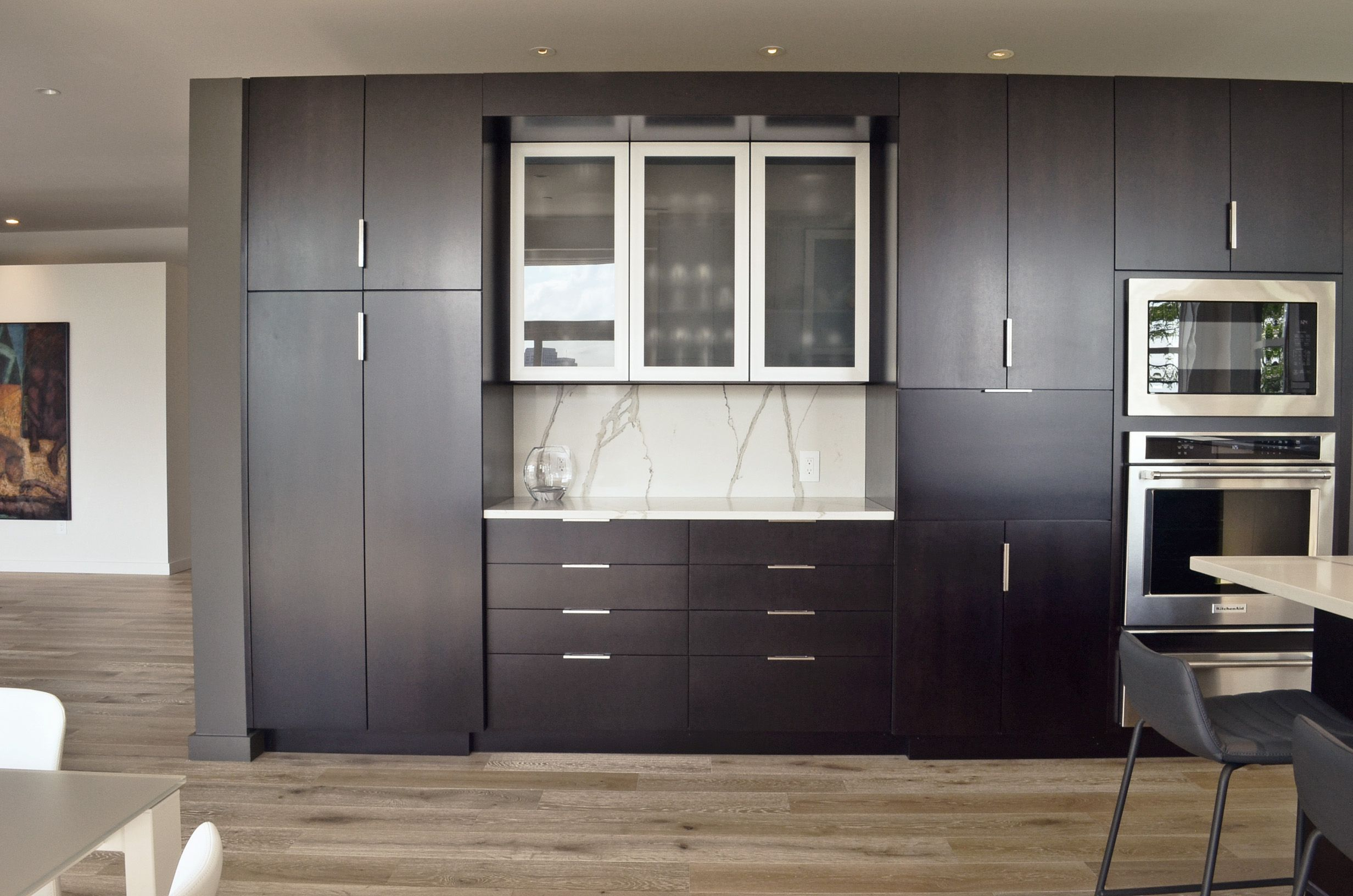 Custom dark wood cabinetry by interior designer, RM Interiors.