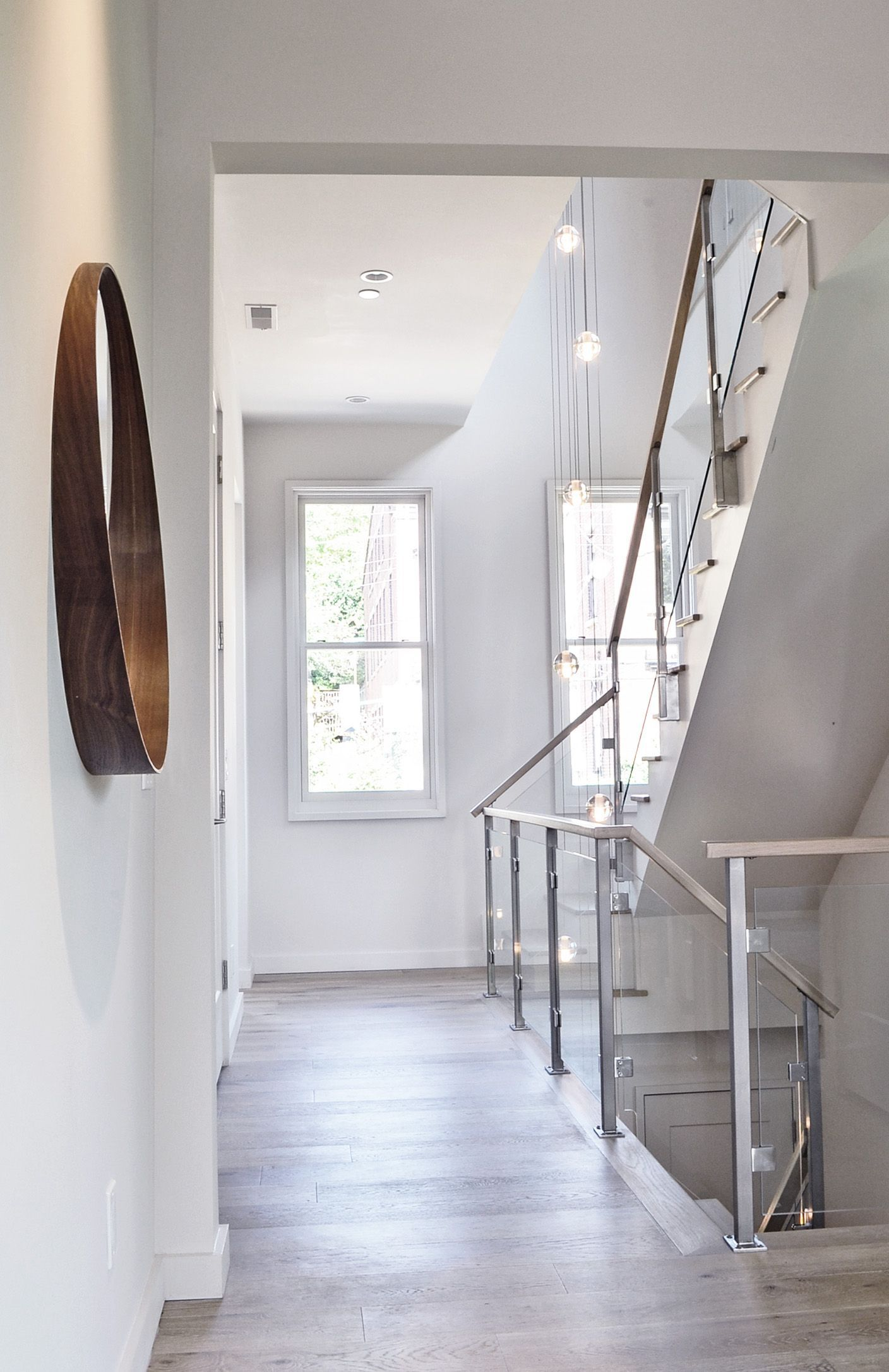 Custom modern steel staircase and railings by Cincinnati Interior Designer, RM Interiors.