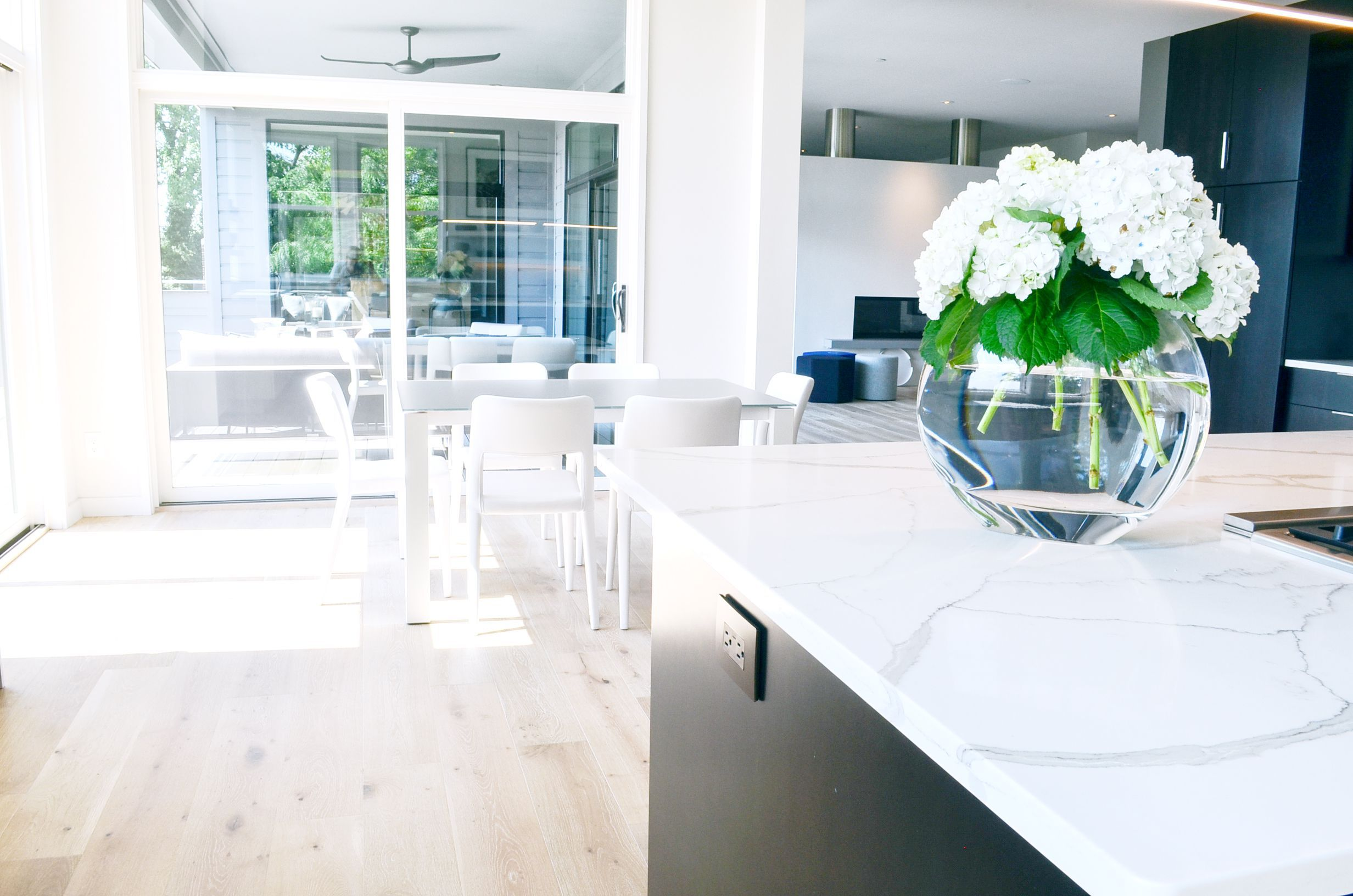 Minimal, modern, and clean white furnishings in a modern kitchen by interior designer, RM Interiors.