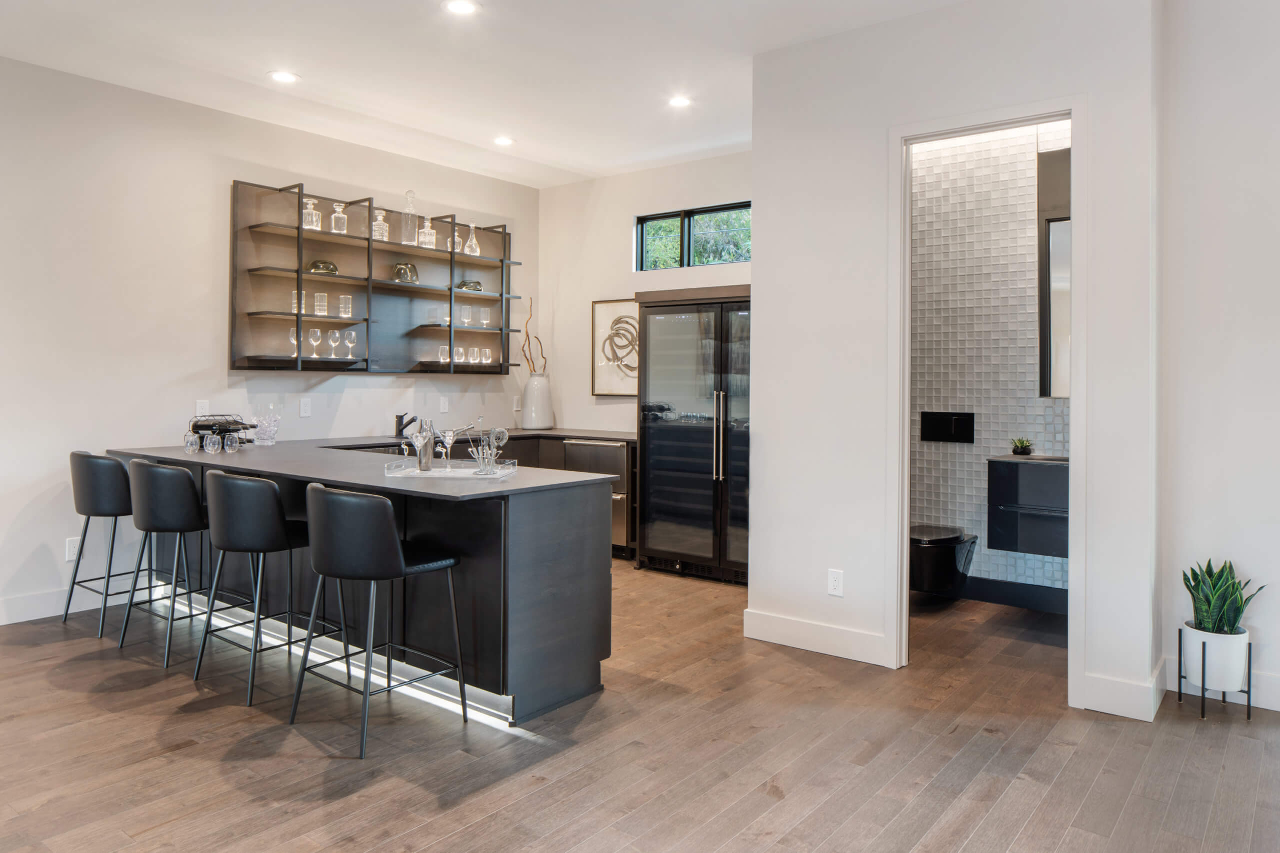 Custom modern bar and powder room located in a custom home in Cincinnati, Ohio. Design by interior designer, RM Interiors.