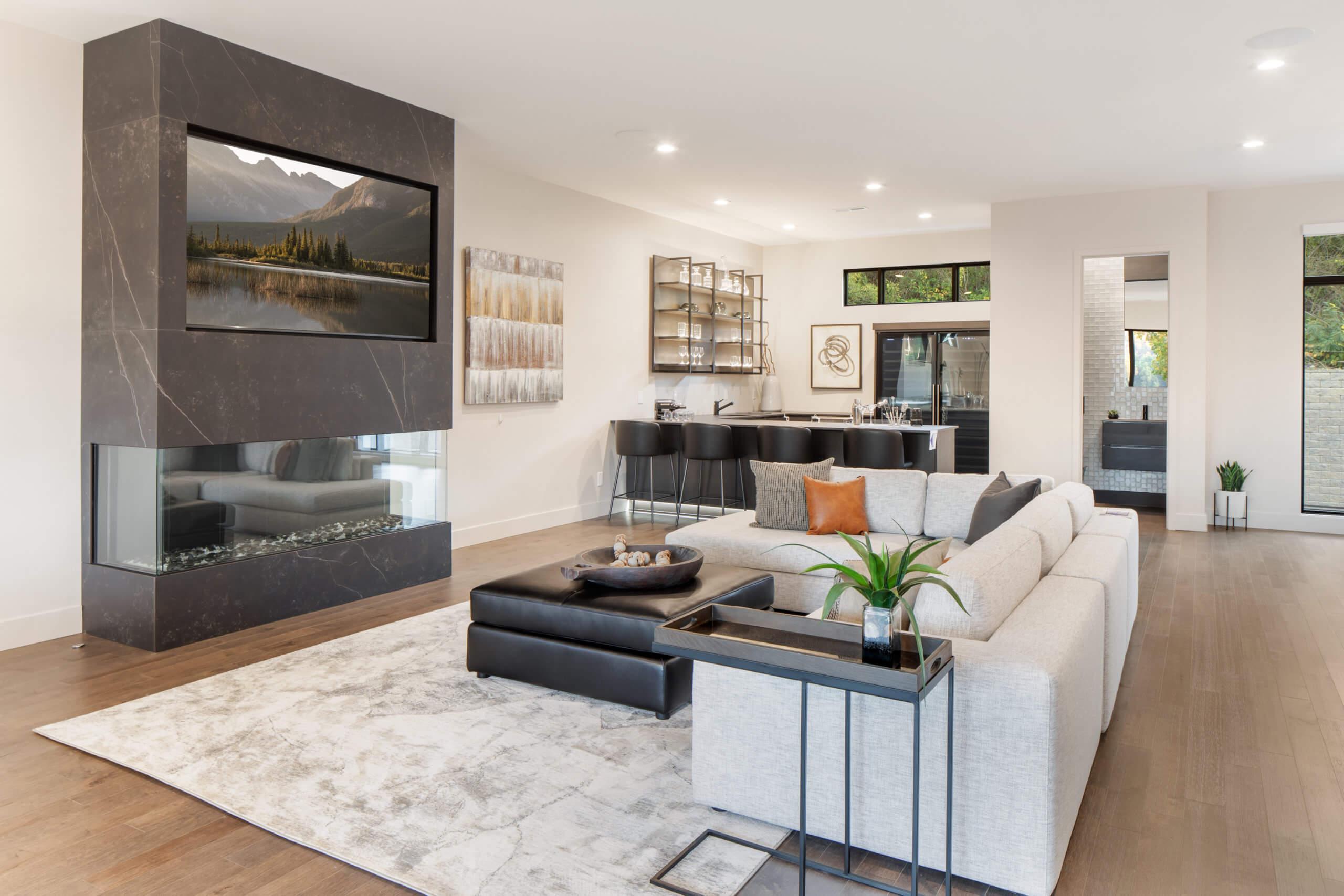 Modern living room and bar area by Cincinnati Interior Designer, RM Interiors.