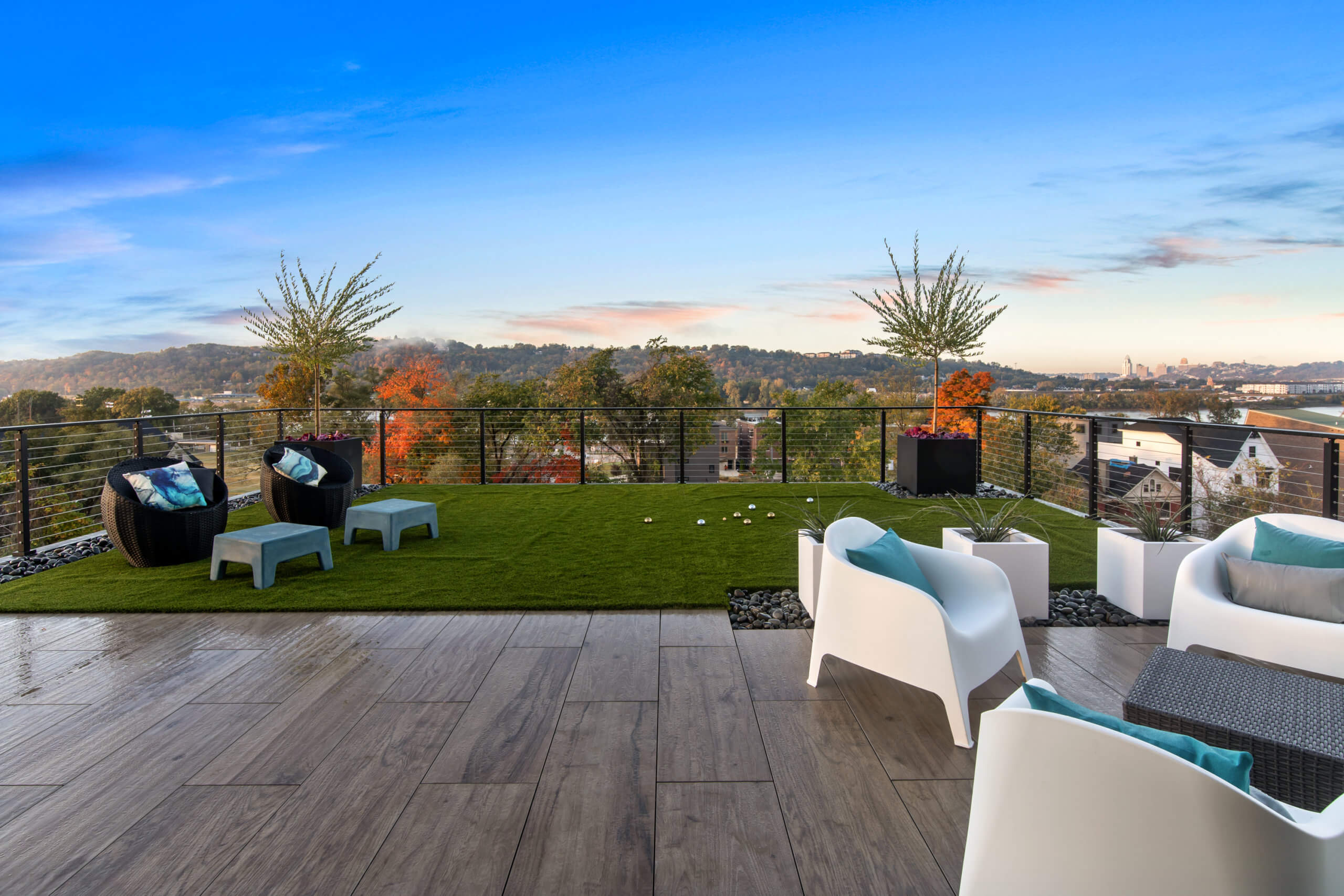 Rooftop patio with astroturf and tile. Designed by Cincinnati Interior Designer, RM Interiors.
