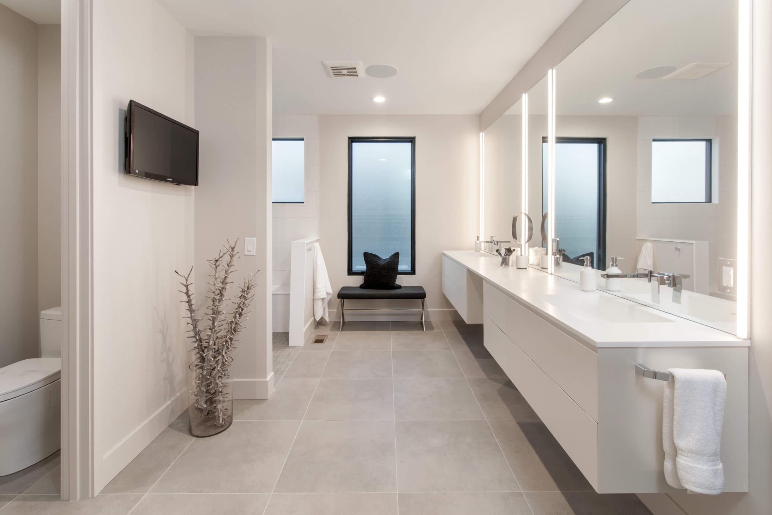 All white custom modern bathroom with custom white vanity. Bathroom designed by Cincinnati's premiere interior designer, Renan Menninger of RM Interiors.