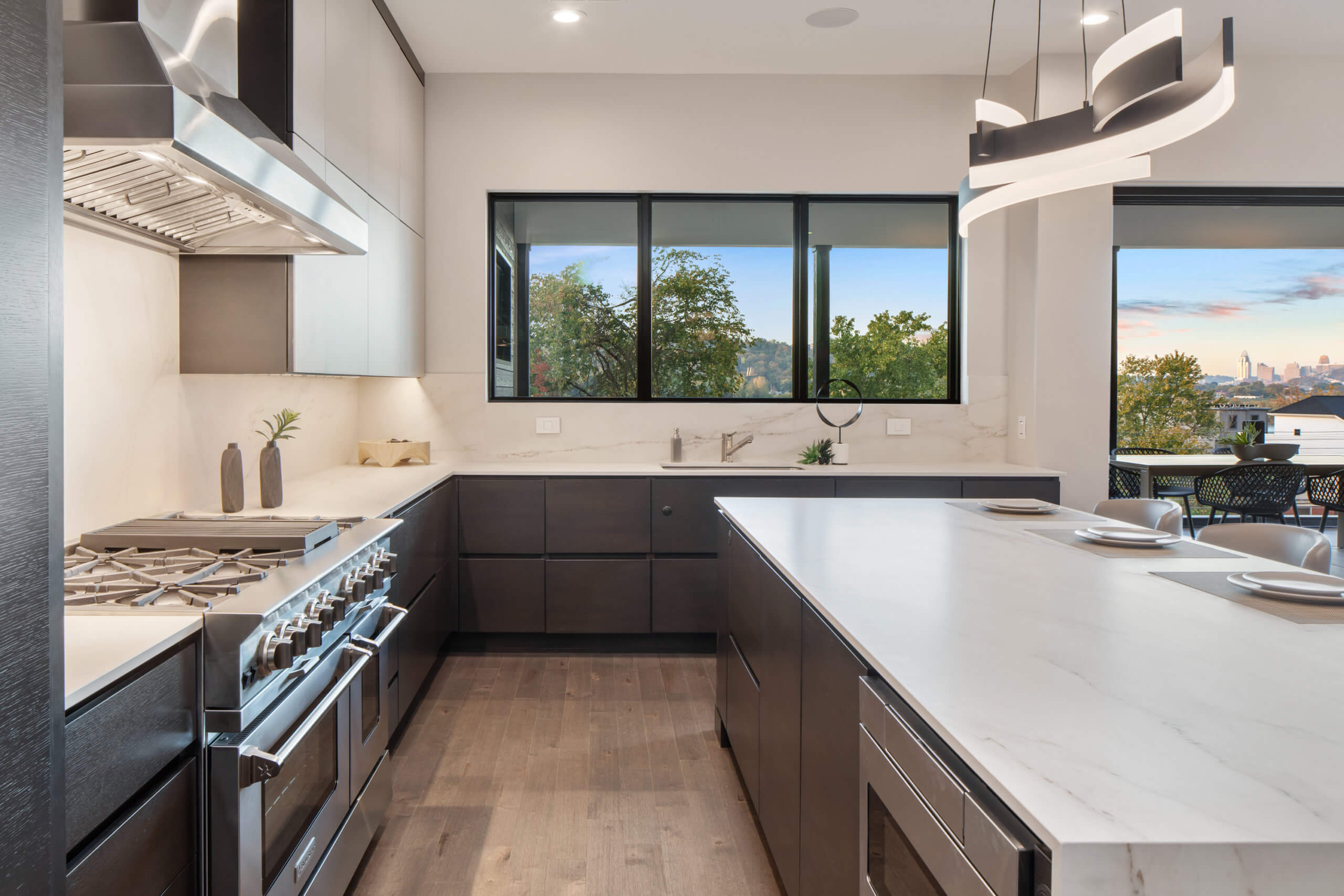 Custom contemporary kitchen's with view of the Ohio River. Kitchen and cabinetry designed by interior designer, RM Interiors.