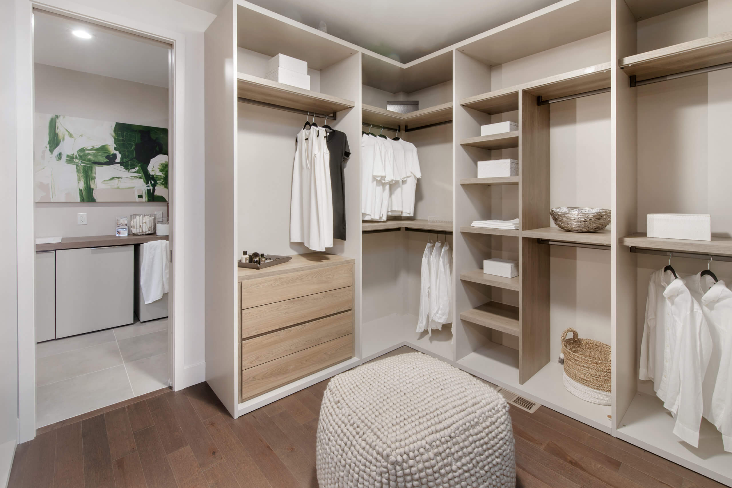 Custom walk-in closet featuring custom cabinetry by Pianca. Custom closed by interior designer RM Interiors.