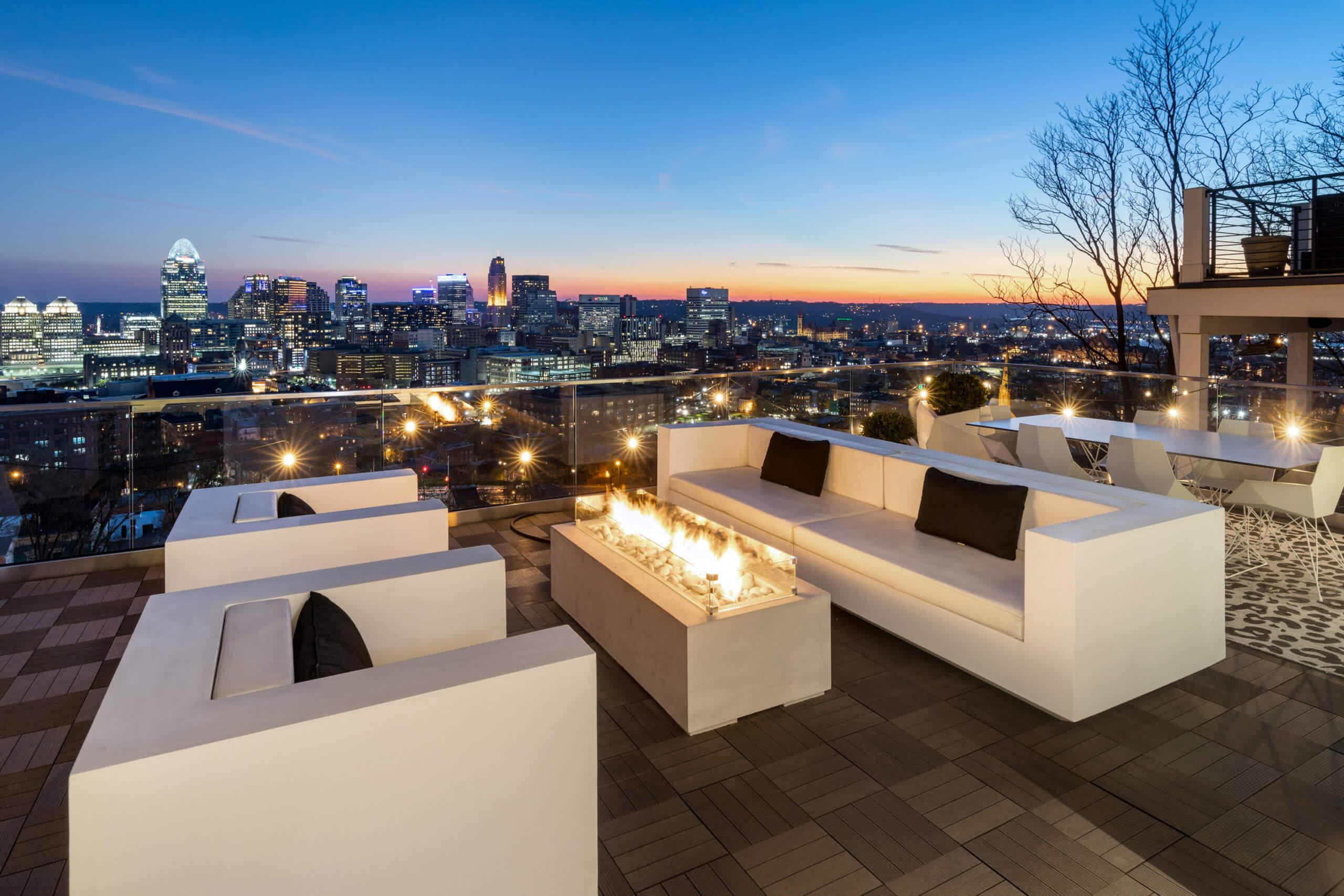 Contemporary Rooftop Design by Cincinnati Interior Designer RM Interiors with Skyline View