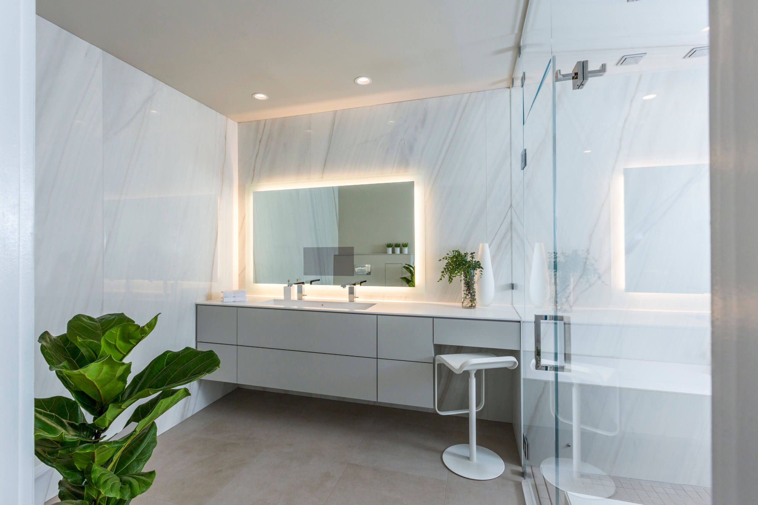 Modern white tile bathroom custom designed by Cincinnati Interior Designer, RM Interiors.